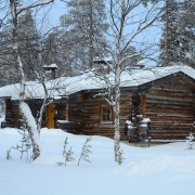 lapland-hotel-luostotunturi-log-cabins-outdoor-at-winter-time